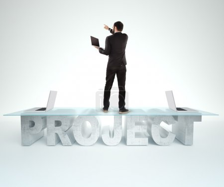 Confident business man standing on the PROJECT table design. Bussines concept