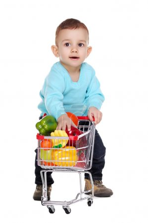 Baby boy putting fruits into his shopping trolley.jpg