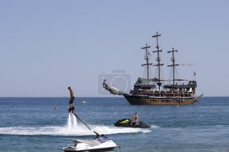 flyboard and yachting stylized pirate schooner
