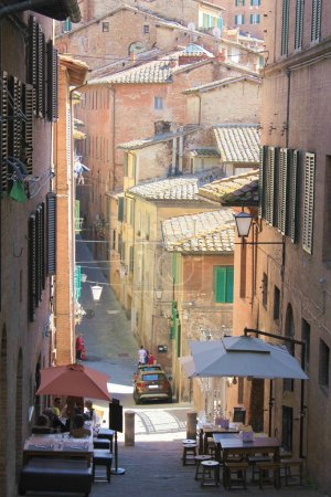 The scenic descent into the ancient city of Siena (Italy).