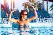 Beautiful sexy woman in the pool