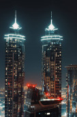 Two High Skyscrapers Glowing With Night Lights. Beautiful Modern Architecture. Luxury Lifestyle. Dubai. United Arab Emirates.