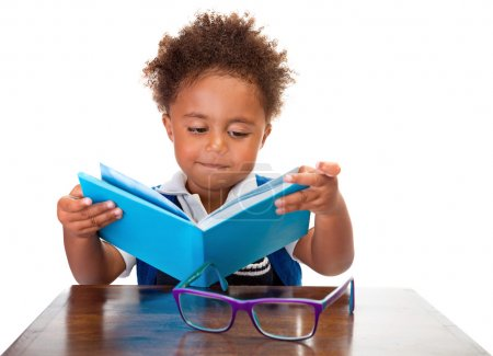 Little boy reading books
