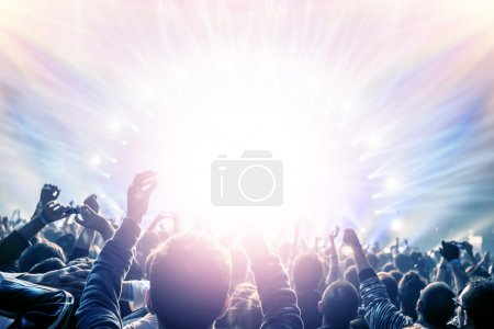 Photo for Outdoor concert, happy people with raised up hand enjoying night in the club, night entertainment, active lifestyle, New Year celebration, partying concept - Royalty Free Image