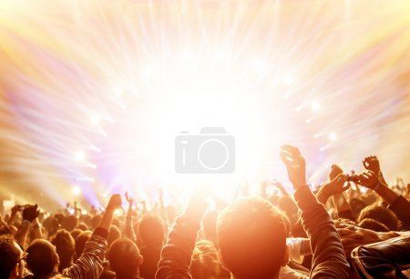 Photo for Active happy people enjoying rock concert, many lights from the stage where playing famous musical band, night entertainment concept - Royalty Free Image