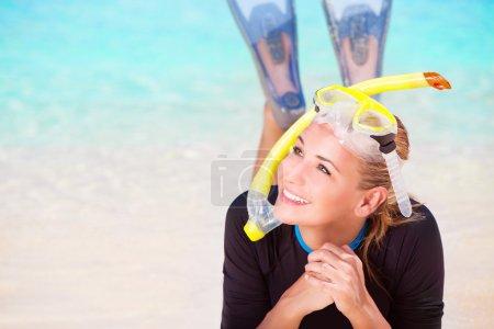 Happy tourist girl snorkeling