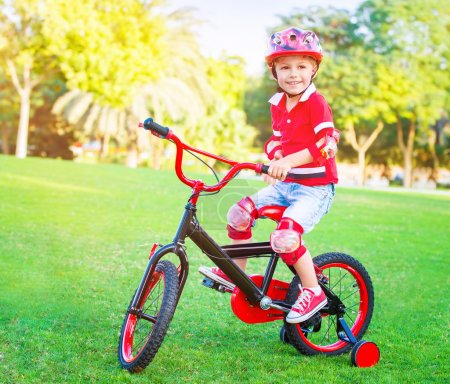 Cute little boy riding a bike