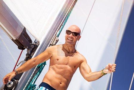 Happy man on sailboat