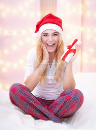 Excited girl with Christmas gift