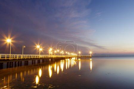 Wooden pier in Jurata at night, Poland