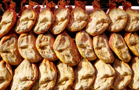 Photo for Jamon serrano ham from Spain whole in a row Iberico - Royalty Free Image