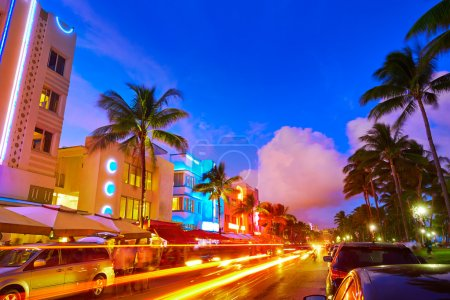 Photo for Miami Beach South Beach sunset in Ocean Drive Florida Art Deco and car lights - Royalty Free Image