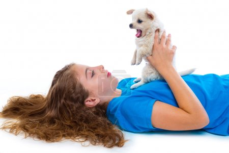 Relaxed kid girl and puppy yawning chihuahua dog