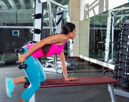 dumbbell triceps kickback girl exercise at gym