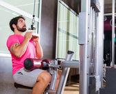 Cable Lat pulldown machine man workout at gym