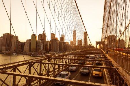 Brooklyn Bridge sunset with Manhattan skyline US
