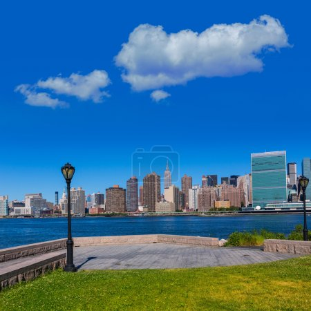 Photo for Manhattan New York sunny skyline East River NYC garden park turf USA - Royalty Free Image