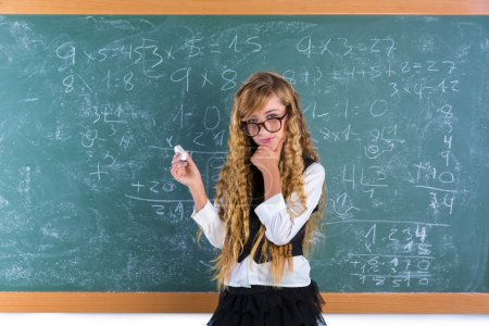 Photo for Clever nerd pupil blond girl in green board thinking student schoolgirl - Royalty Free Image