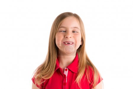 Foto de Crossed eyes blond kid girl funny expression gesture in white background - Imagen libre de derechos