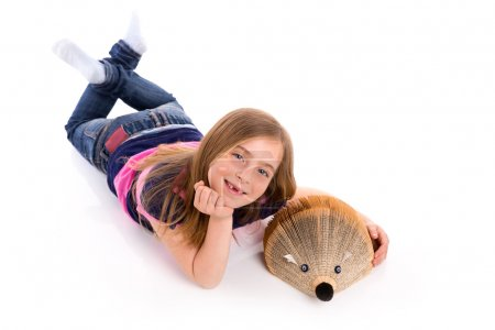 Foto de Blond kid girl student with hedgehog book on white background - Imagen libre de derechos