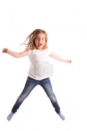 Foto de Blond kid girl indented jumping high wind on hair denim jeans at white background - Imagen libre de derechos