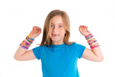 Photo for Loom rubber bands bracelets blond kid girl smiling open arms gesture on white background - Royalty Free Image