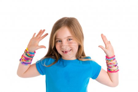 Foto de Loom rubber bands bracelets blond kid girl smiling open hands gesture on white background - Imagen libre de derechos