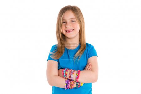Foto de Loom rubber bands bracelets blond kid girl smiling crossed arms on white background - Imagen libre de derechos