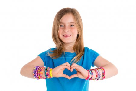 Foto de Loom rubber bands bracelets blond kid girl heart shape fingers gesture on white - Imagen libre de derechos