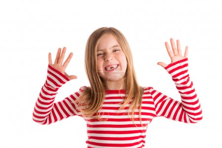 Foto de Blond indented kid girl open mounth and hands happy expression gesture on white - Imagen libre de derechos