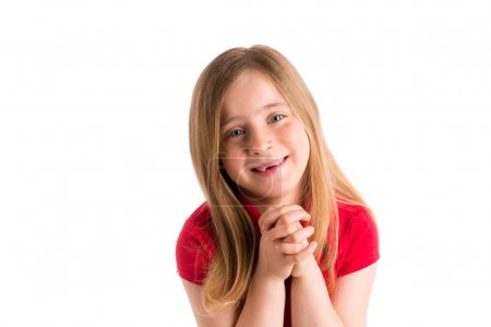 Foto de Blond indented kid girl praying hands gesture in white background - Imagen libre de derechos