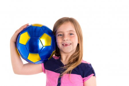 Foto de Football soccer blond kid girl happy player with ball on white background - Imagen libre de derechos