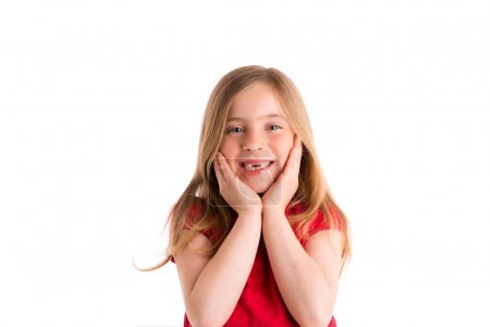 Foto de Blond indented kid girl surprised gesture hands in face on white background - Imagen libre de derechos