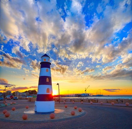 Denia sunset lighthouse at dusk in Alicante