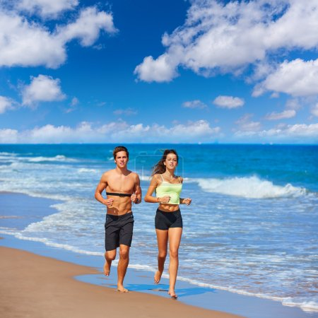 Couple young running in the beach in summer