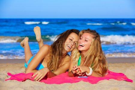 friends girls having fun laughing lying beach sand