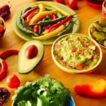 Mexican food mixed guacamole nachos chili sauce di...