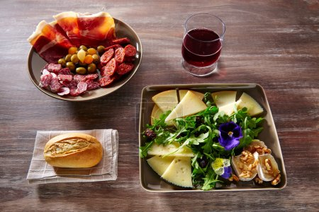 Photo for Spain food tapas ham sausage and salad with cheese honey and nuts - Royalty Free Image