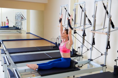 Pilates reformer woman rowing row exercise