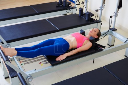Pilates reformer woman foot work exercise