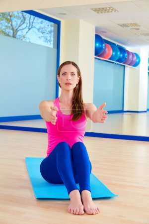 Pilates woman stretching exercise workout at gym