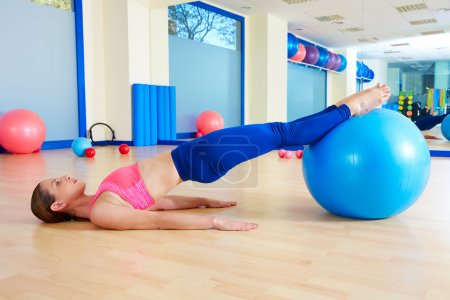 Pilates woman pelvic lift fitball exercise workout...
