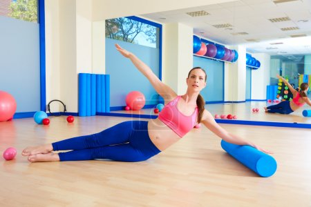 Pilates woman roller exercise workout at gym