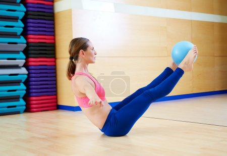 Pilates woman stability ball teaser exercise