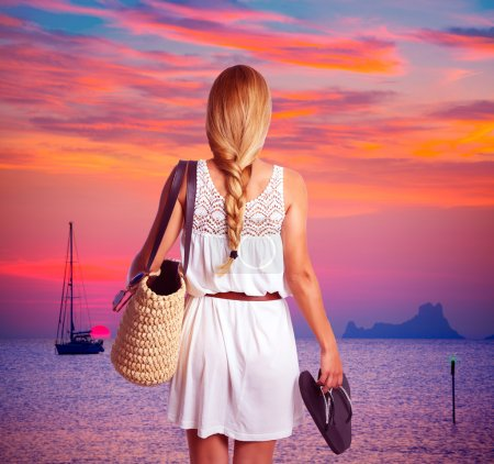 Blond braid tourist girl looking sunset with flip flop