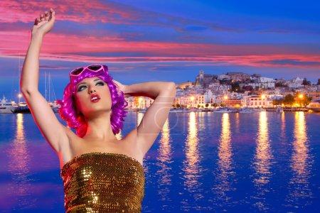 Girl tourist pink wig in Ibiza nightlife at sunset