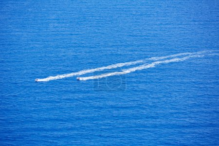 Blue sea ocean with watercrafts wake aerial