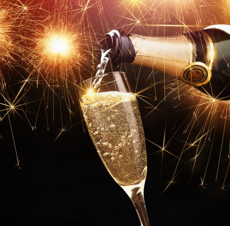 Photo pour Happy new year, champagne with sparklers on dark background - image libre de droit