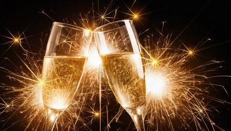 Photo for Glasses of champagne and sparklers on bright background with sparklers - Royalty Free Image