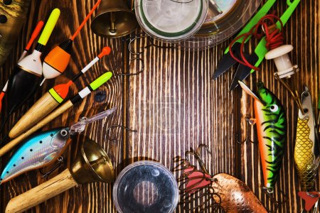 Photo for Fishing tackle on wooden background - Royalty Free Image